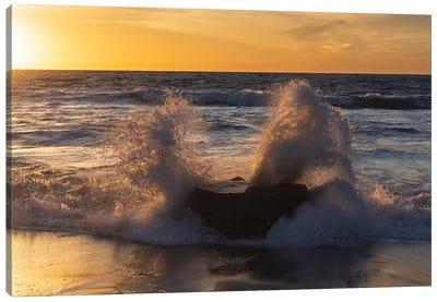 Golden sunset light coming through the white water crashing off a rock Canvas Art Print