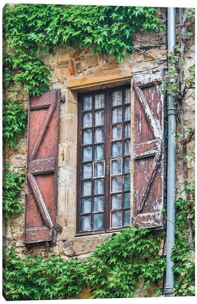France, Cordes-sur-Ciel. Weathered shutters and window. Canvas Art Print