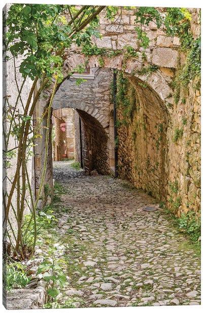 France, Saint-Cirq Lapopie. Tunneled walkway Canvas Art Print