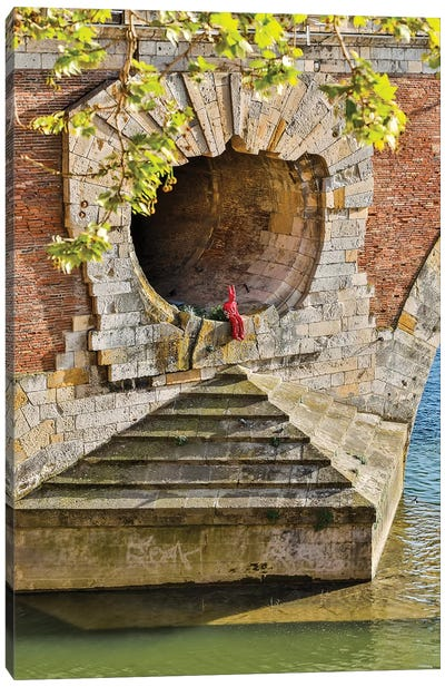 France, Toulouse. Red Devil sitting in opening of the Pont Neuf (Bridge) Canvas Art Print