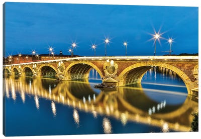 France, Toulouse. View of Pont Neuf and the Garonne River and reflections at sunset Canvas Art Print