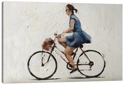 Cycling In A Blue Dress Canvas Art Print