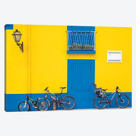 Portugal, Aveiro. Yellow house with blue shutters, windows and doors in the city of Aveiro. Canvas Print #JEG13} by Julie Eggers Canvas Wall Art