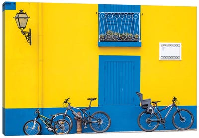 Portugal, Aveiro. Yellow house with blue shutters, windows and doors in the city of Aveiro. Canvas Art Print
