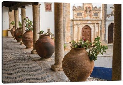 Portugal, Obidos. Ceramic pots adorn a ledge along a building. Canvas Art Print