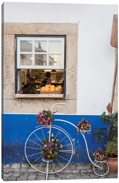 Portugal, Obidos. Cute bicycle planter in front of a bakery in the walled city of Obidos. Canvas Art Print