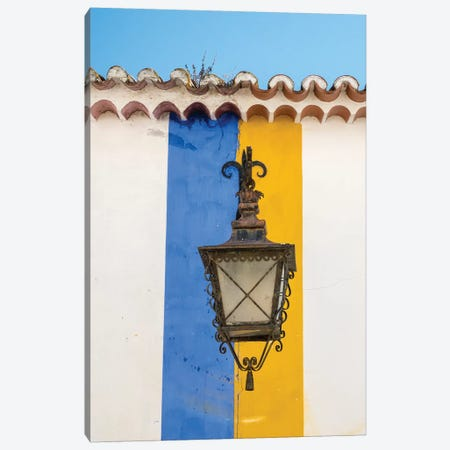 Portugal, Obidos. Wrought iron lantern hanging from a colorful stripped wall in the walled town. Canvas Print #JEG25} by Julie Eggers Canvas Artwork
