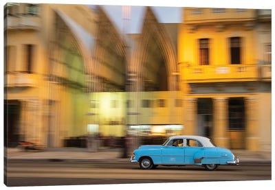 Cuba, Havana, classic car in motion at dusk on Malecon. Canvas Art Print