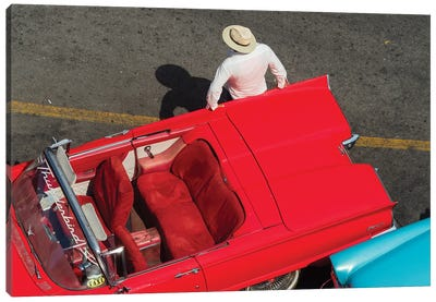 Cuba, Havana, Havana Vieja (Old Havana), red classic convertible and driver, viewed from above. Canvas Art Print