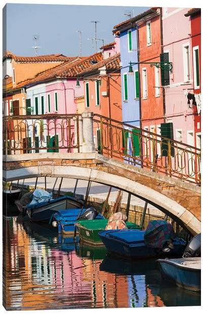 Italy, Burano. Reflection of colorful houses in canal. Canvas Art Print