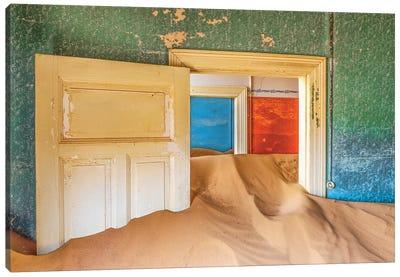 Africa, Namibia, Kolmanskop. Doorways and drifting sand in an abandoned diamond mining town. Canvas Art Print