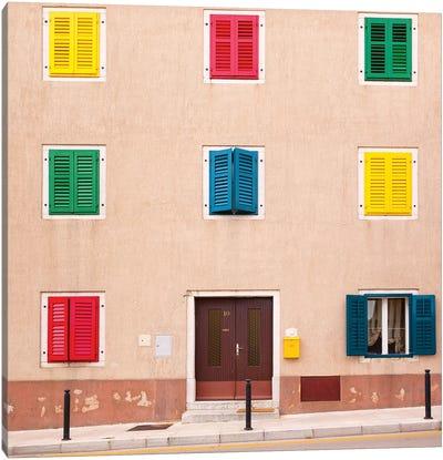 Croatia, Vrsar. Building with colorful shutters.  Canvas Art Print