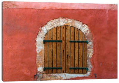 France, Provence, Roussillon. Wooden shutters in red wall.  Canvas Art Print