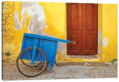 Greece, Rhodes. House with blue cart in front.  Canvas Art Print