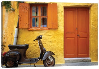 Greece, Rhodes. Vespa motorbike and colorful house exterior.  Canvas Art Print