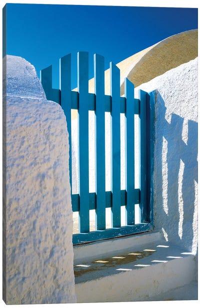 Greece, Santorini, Oia. Blue gate of home.  Canvas Art Print