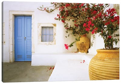 Greece, Santorini. Blue door to house and potted flowers.  Canvas Art Print