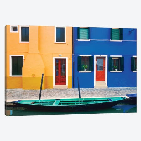 Italy, Burano. Colorful house exteriors and boat in canal.  Canvas Print #JYG265} by Jaynes Gallery Canvas Art