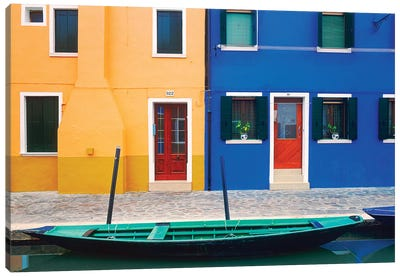 Italy, Burano. Colorful house exteriors and boat in canal.  Canvas Art Print