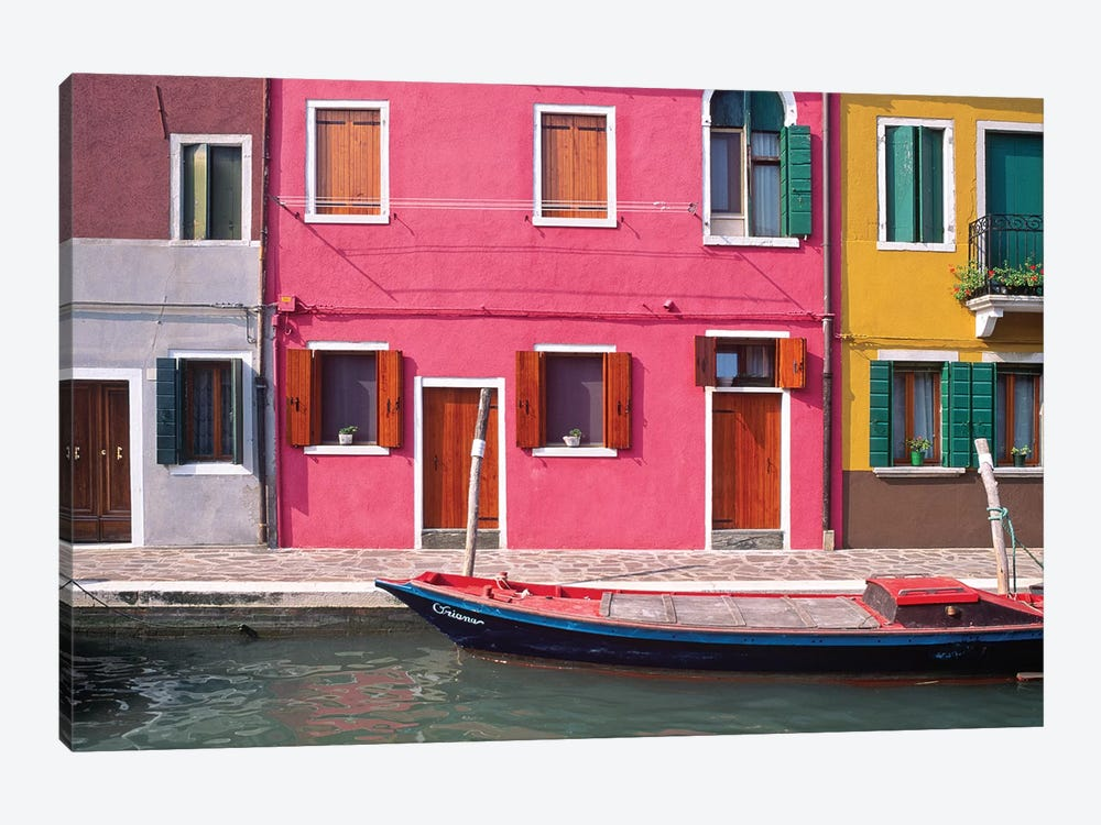 Italy, Burano. Colorful house exteriors and boat in canal.  by Jaynes Gallery 1-piece Art Print