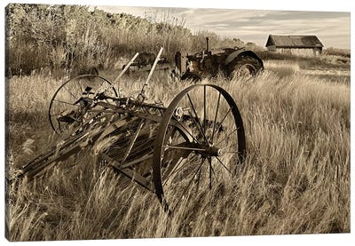 Canada. Black and white of old farm machinery in field. Canvas Art Print