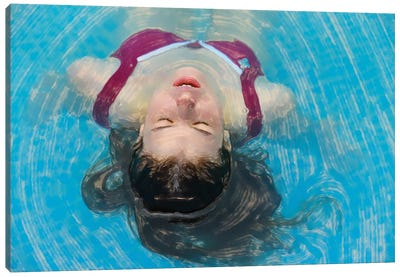 Young Woman Relaxing In The Pool Canvas Art Print