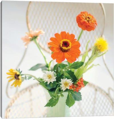 Orange Flowers On Iron Chair Canvas Art Print
