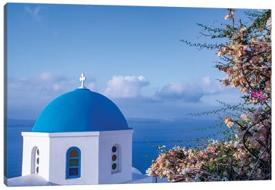 Blue domed Greek Orthodox church with bougainvillea flowers in Oia, Santorini, Greece. Canvas Art Print