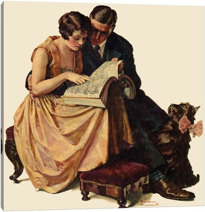 Young Couple Looking at Catalogue Canvas Print #NRL226