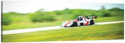White & Red Formula 1 On The Track In Motion Canvas Art Print