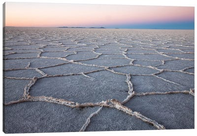 The largest salt flats in the world located in Uyuni, bolivia as the sun is rising in winter. Canvas Art Print