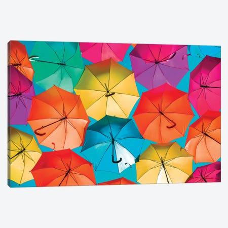 Colourful Umbrellas  - Turquoise Sky Canvas Print #PHD526} by Philippe Hugonnard Canvas Wall Art