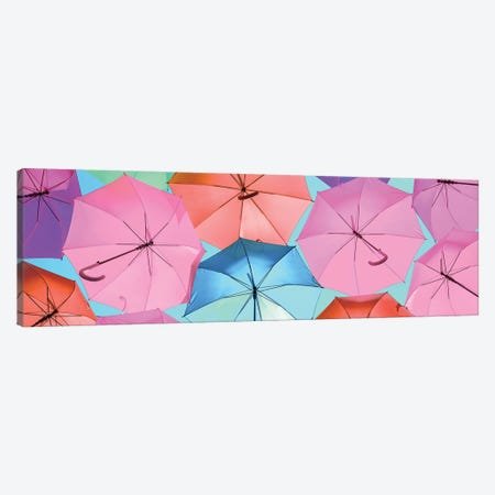 Colourful Umbrellas  - Light Blue Sky Canvas Print #PHD533} by Philippe Hugonnard Canvas Wall Art