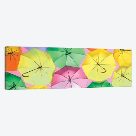 Colourful Umbrellas  - Light Pink Sky Canvas Print #PHD536} by Philippe Hugonnard Canvas Print