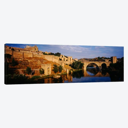 Historic Landscape Along Rio Tajo Featuring Puente de San Martin, Toledo, Spain Canvas Print #PIM1004} by Panoramic Images Canvas Art