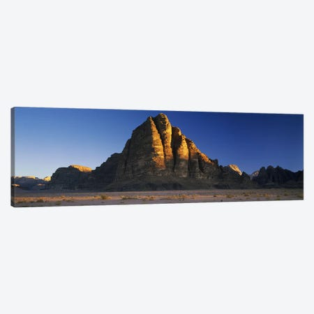 Rock formations on a landscapeSeven Pillars of Wisdom, Wadi Rum, Jordan Canvas Print #PIM10120} by Panoramic Images Canvas Print