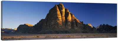 Rock formations on a landscapeSeven Pillars of Wisdom, Wadi Rum, Jordan Canvas Art Print