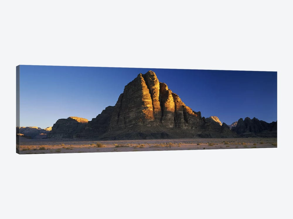 Rock formations on a landscapeSeven Pillars of Wisdom, Wadi Rum, Jordan by Panoramic Images 1-piece Canvas Art Print
