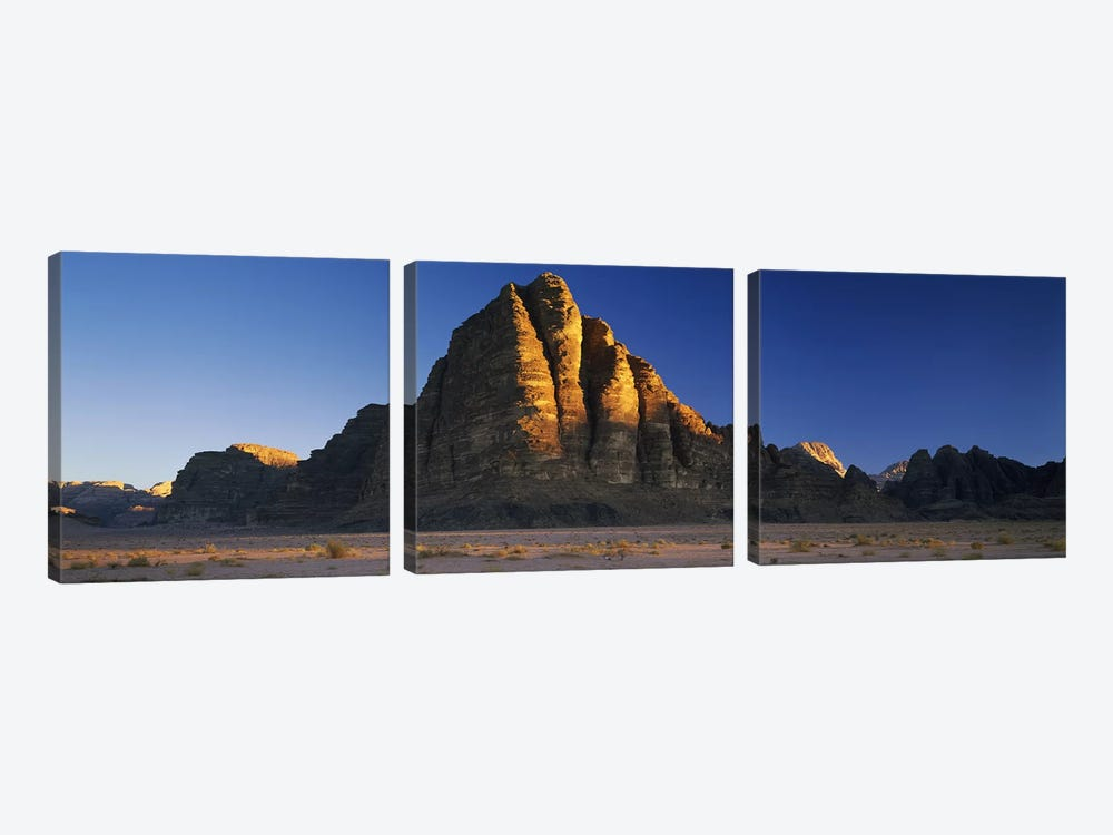 Rock formations on a landscapeSeven Pillars of Wisdom, Wadi Rum, Jordan by Panoramic Images 3-piece Canvas Art Print
