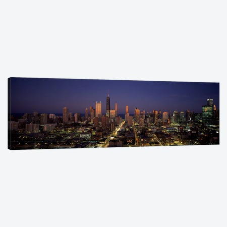 Skyscrapers in a city lit up at dusk, Chicago, Illinois, USA Canvas Print #PIM1015} by Panoramic Images Canvas Print