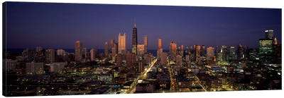 Skyscrapers in a city lit up at dusk, Chicago, Illinois, USA Canvas Print #PIM1015