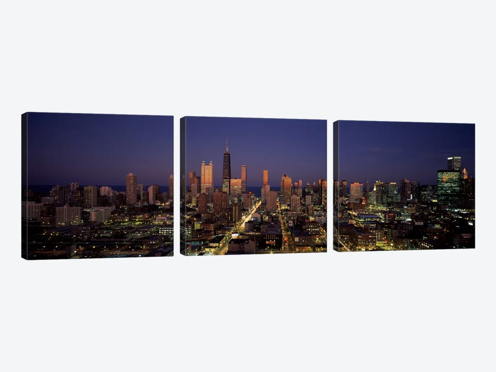 Skyscrapers in a city lit up at dusk, Chicago, Illinois, USA by Panoramic Images 3-piece Canvas Art