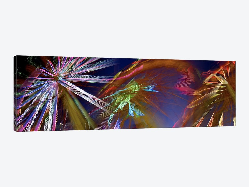 Ferris wheel spinning at night by Panoramic Images 1-piece Canvas Art