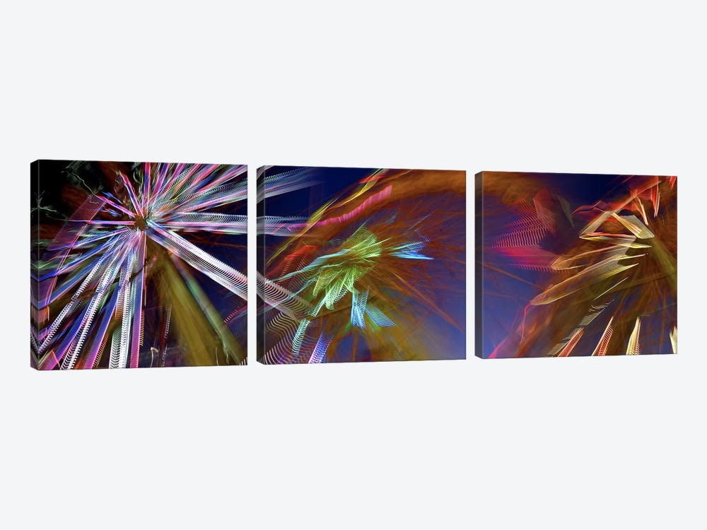 Ferris wheel spinning at night by Panoramic Images 3-piece Canvas Wall Art