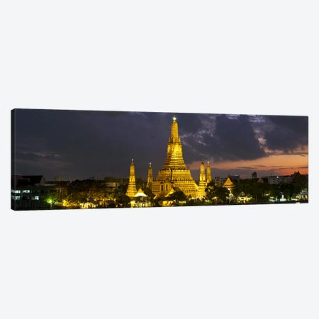 Buddhist temple lit up at dawn, Wat Arun, Chao Phraya River, Bangkok, Thailand Canvas Print #PIM10336} by Panoramic Images Canvas Art Print