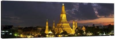 Buddhist temple lit up at dawn, Wat Arun, Chao Phraya River, Bangkok, Thailand Canvas Art Print