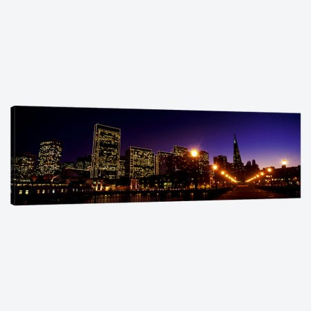 Buildings at the waterfront lit up at dusk, San Francisco, California, USA Canvas Print #PIM10425} by Panoramic Images Art Print
