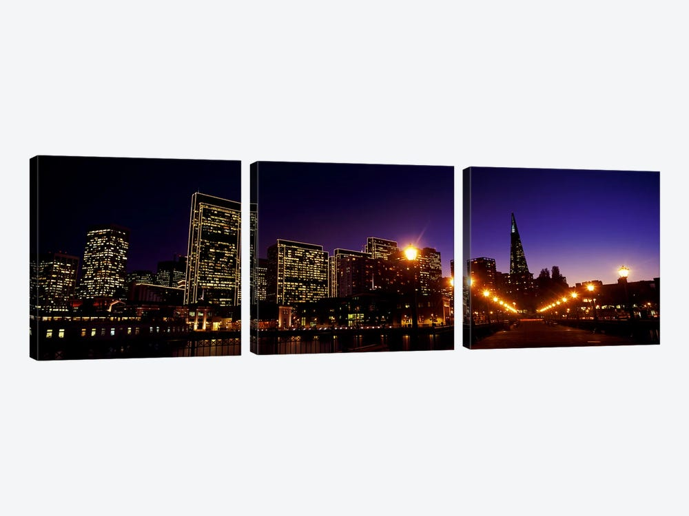 Buildings at the waterfront lit up at dusk, San Francisco, California, USA by Panoramic Images 3-piece Canvas Artwork
