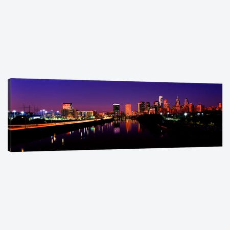Buildings lit up at the waterfront, Philadelphia, Schuylkill River, Pennsylvania, USA Canvas Print #PIM10571} by Panoramic Images Canvas Artwork