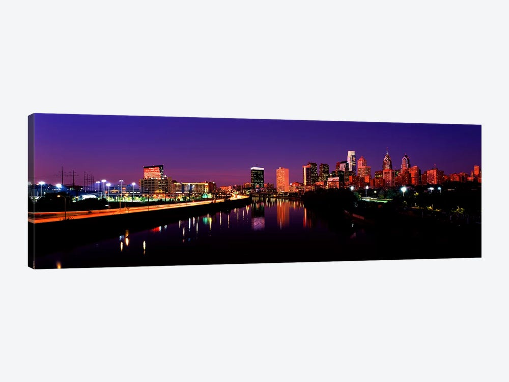 Buildings lit up at the waterfront, Philadelphia, Schuylkill River, Pennsylvania, USA by Panoramic Images 1-piece Canvas Artwork